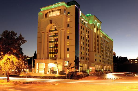 Exterior view of Holiday Inn Sandton Rivonia Road by night.