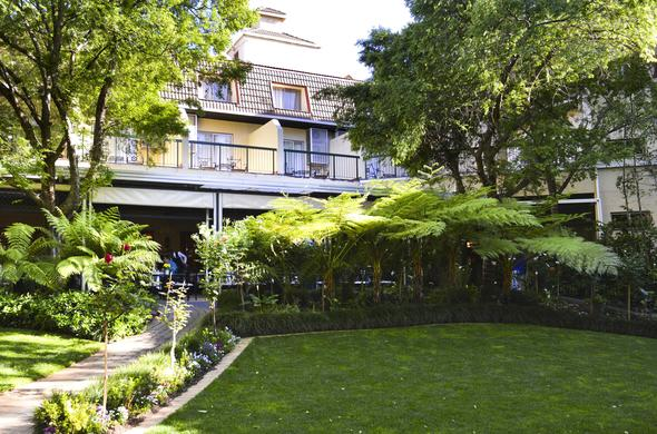 Exterior with beautiful garden at Protea Hotel Balalaika.